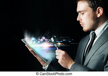 Examine a computer - Businessman looking for virus with a...