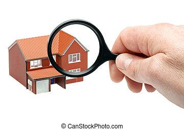 Examining a house through a magnifying glass