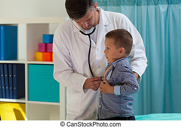 Examining little boy