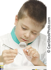 Examining specimen - Young school scientist examining...