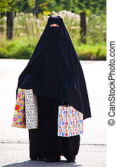 Example picture Islam. Muslim veiled woman with Burqa -...