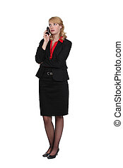 Exasperated woman talking on her mobile phone