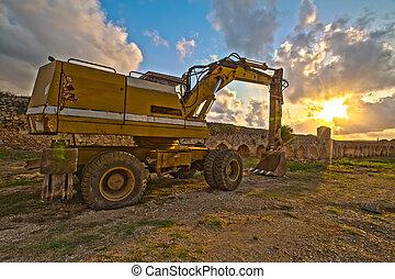 excavador, en, ocaso