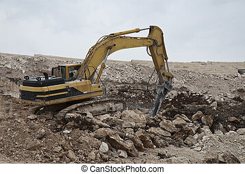 Excavation in stone - Machine with hammer for excavation in...