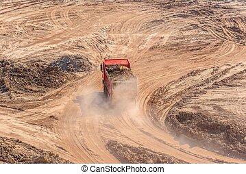 Excavation site with construction machine