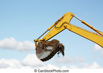 Excavation - The mechanical arm of an excavator with a...
