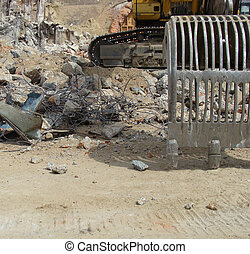 excavator and demolition rubble on an industrial construction site