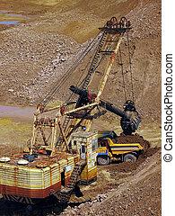 excavator and dump truck in quarry