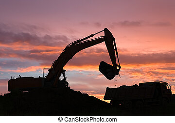 excavator and dumper truck - Heavy excavator loading dumper...