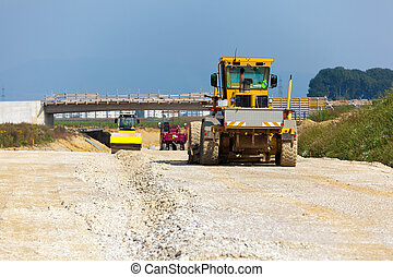 Excavator at a road construction site - Road construction. ...
