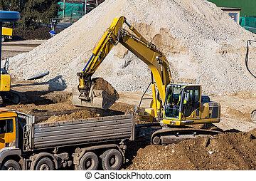 excavator at construction site during excavation - excavator...
