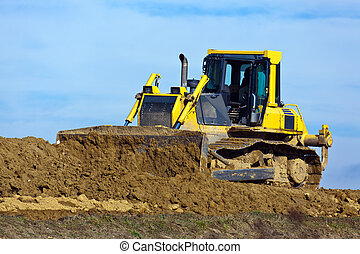 Excavator at construction work on site - An excavator on a...