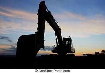 Excavator at sunset - Silhouette view of a construction...
