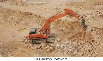 Excavator breaking road with hydrohammer drill. Time Lapse