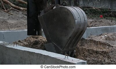 Excavator Bucket Digs the Earth - The crawler excavator with...