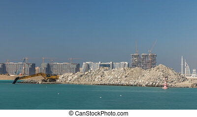 Excavator building a new part on the Palm Jumeirah...