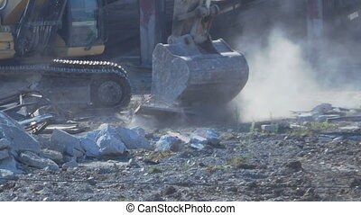 Excavator Cleans the Debris - Excavator is cleaning the site...