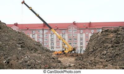 Excavator, construction crane work on construction