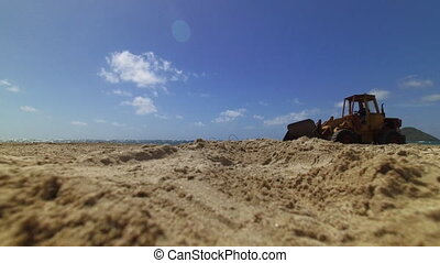 Excavator crossing a camera shot - A steady shot of a ...