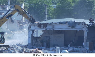 Excavator Demolishes Building - Excavator is demolishing a...