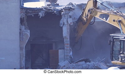 Excavator Demolishes Walls - Excavator is dismantle the wall...