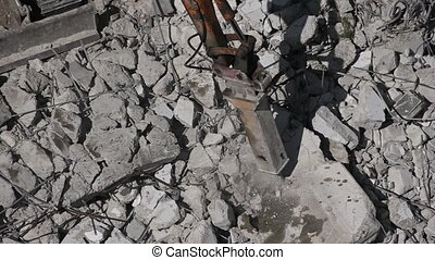 Excavator destroying concrete wall - Zoom out of excavator ...