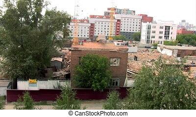 excavator destroys brick house
