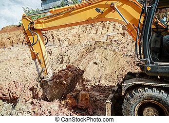 Excavator digging a hole. Earthwork.