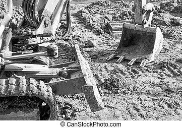 Excavator digging a hole