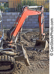 Excavator digging a hole - Excavator mechanical shovel...