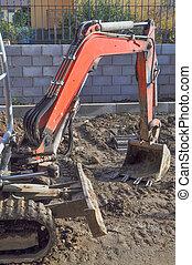 Excavator digging a hole - Excavator mechanical shovel...