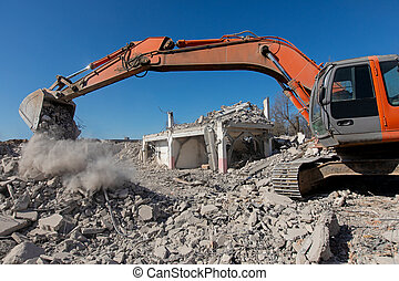 Excavator digging at construction site during house demolition