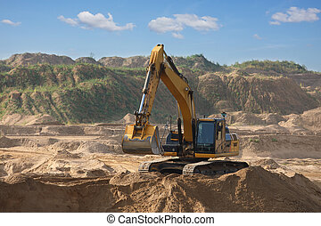 Excavator digs the sand