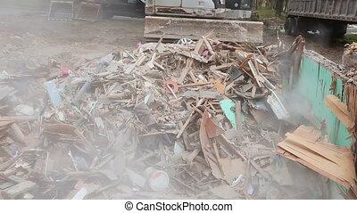 broken house after tragedy excavator disassembles structure tornado