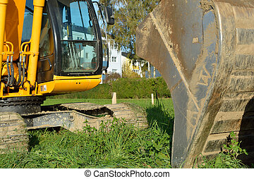 Excavator during excavation work - Kettenbagger -...