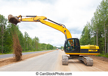 Excavator during road construction - Excavator working on ...