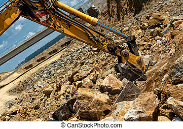 Excavator engineer moving sand and rocks with heavy duty...