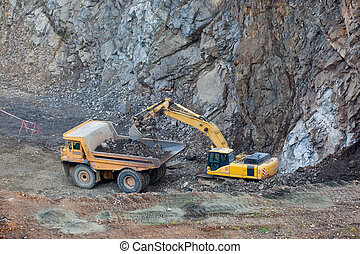 Excavator filling the truck