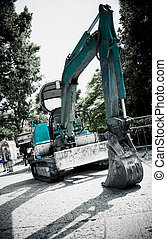 Excavator in a city