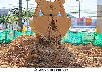 excavator in action digging soil