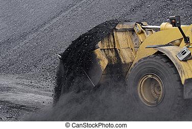 Excavator in coals.