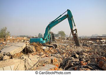 excavator in the construction debris clean up site -...