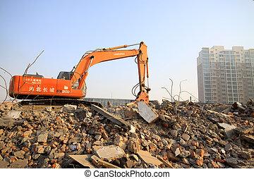 excavator in the construction debris clean up site