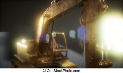 excavator in the dark with bright lights
