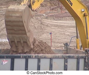 Excavator dig ground and load in truck. Bulldozer pushing earth. Preparatory construction work.
