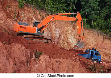 excavator loader machine during earthmoving works outdoors.