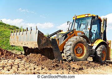 Wheel loader Excavator with backhoe unloading sand at eathmoving works in construction site