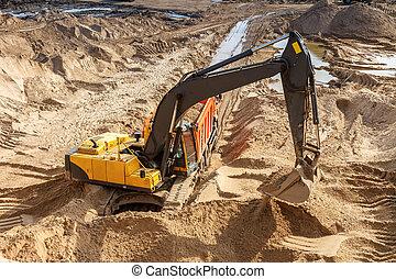 Excavator Loading Dumper Truck at sunny day