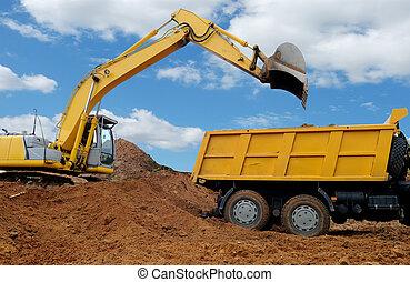 Excavator loading dumper truck tipper in sand pit over blue ...