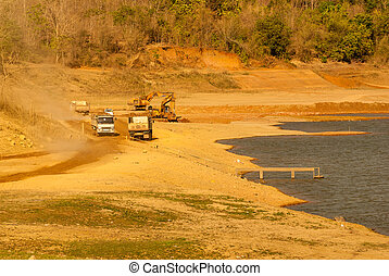 excavator loading dumper truck with sand - arm, background, ...